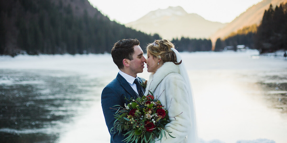 wedding couple kissing at lake montriond near morzine