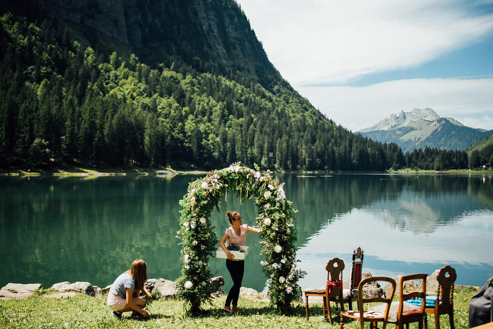 Florist setting up the flower arch for a ceremony at Lake Montriond in the French Alps