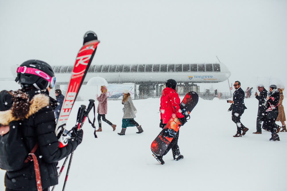 Wedding guests and skiers at the top of Megeve Chairlift