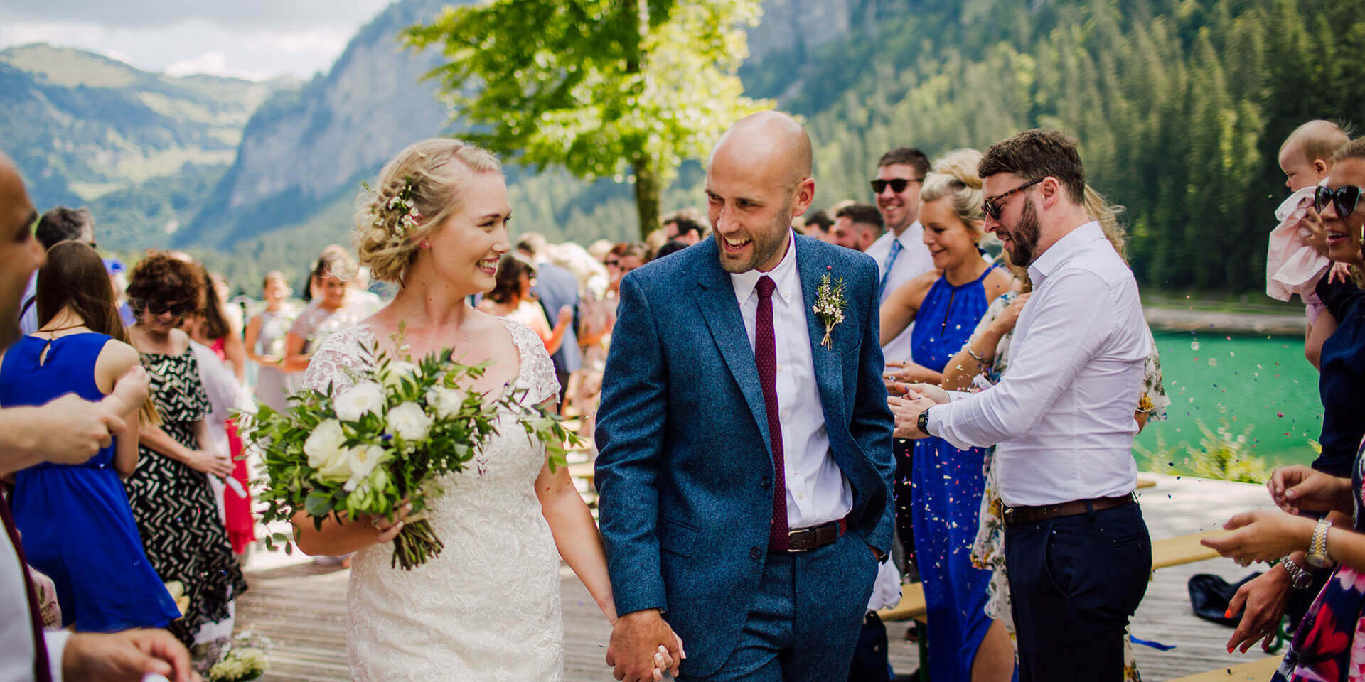 bride and groom celebrating their wedding at the domaine du baron in montriond