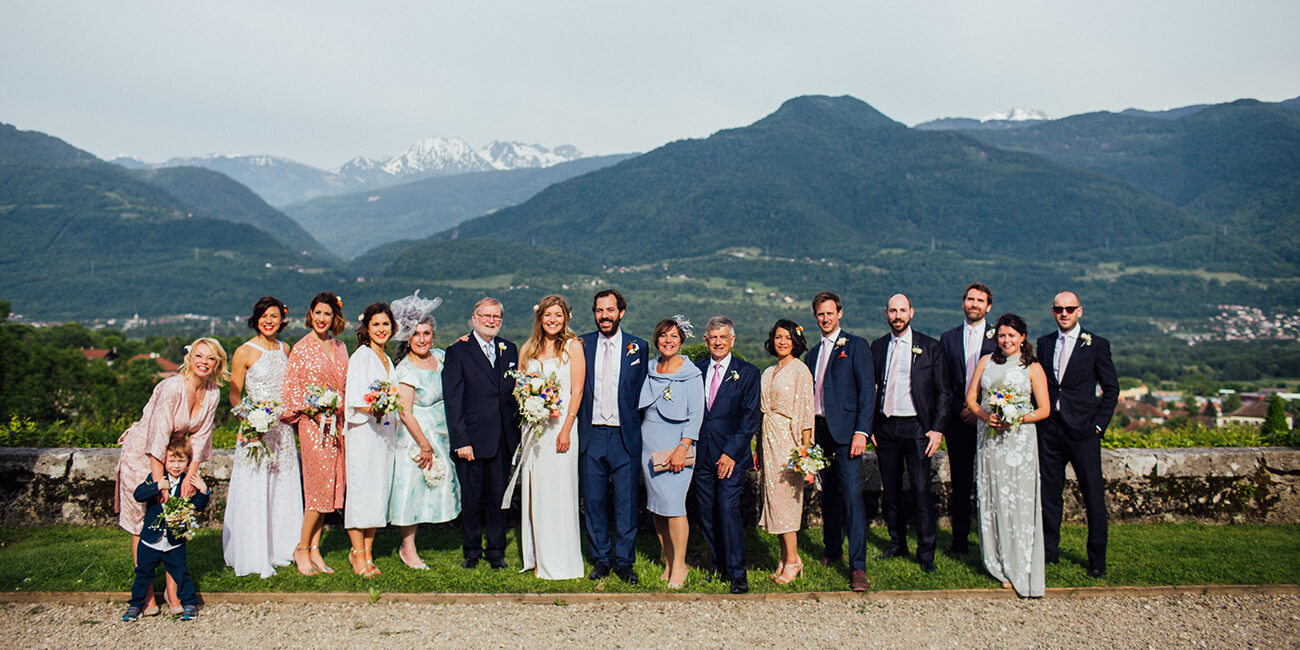 formal group family photo in a wedding at the french alps