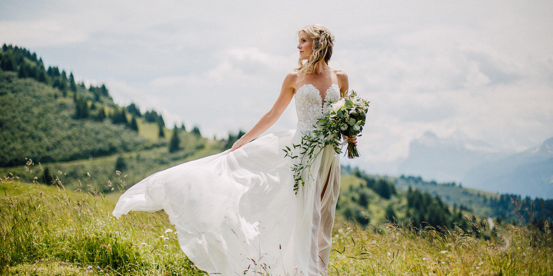 bride on her wedding in morzine with the mountains in the background