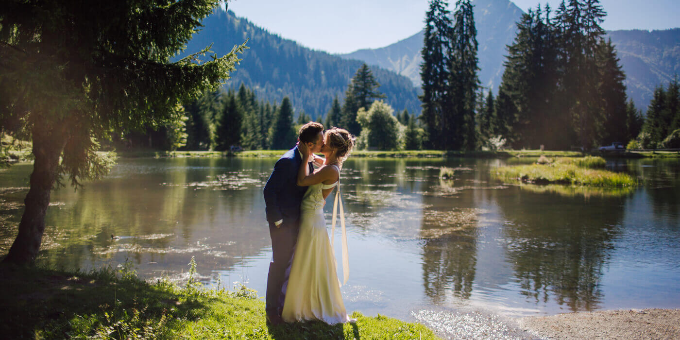 wedding in the french alps a married couple in alpine lake